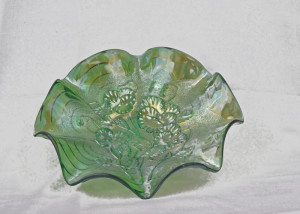 "Green, fluted plate with Imperial ""pansies"" design."