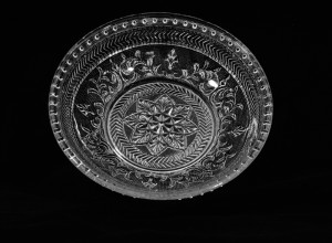 Small dish with pattern of flowers, chevrons and dots